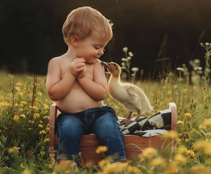 A Photographer Captures Kids Cuddling With Animals, and It's the Purest Thing We've Ever Seen