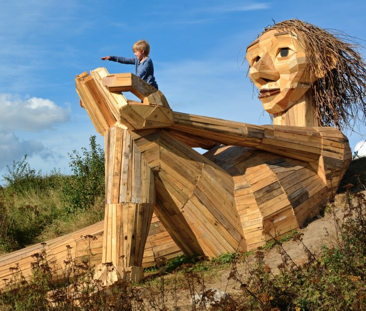 This Artist Made 34 Giant Wood Sculptures, and They're Both Terrifying and Cute
